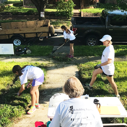 Members working in a yard